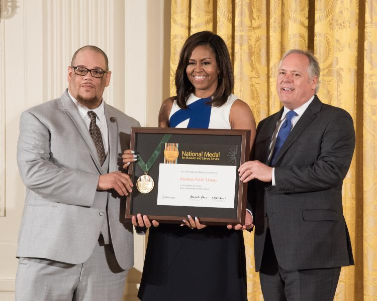Rob Franklin and Library Director Greg Mickells accept a 2016 National Medal for Library Service awarded by First Lady Michelle Obama at The White House