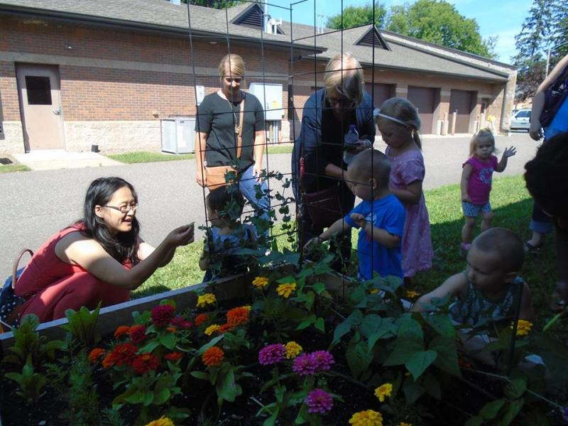 Children and adults learn about plants in the Minocqua Public Library garden