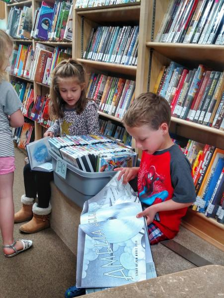 Kids finding books on the bookmobile