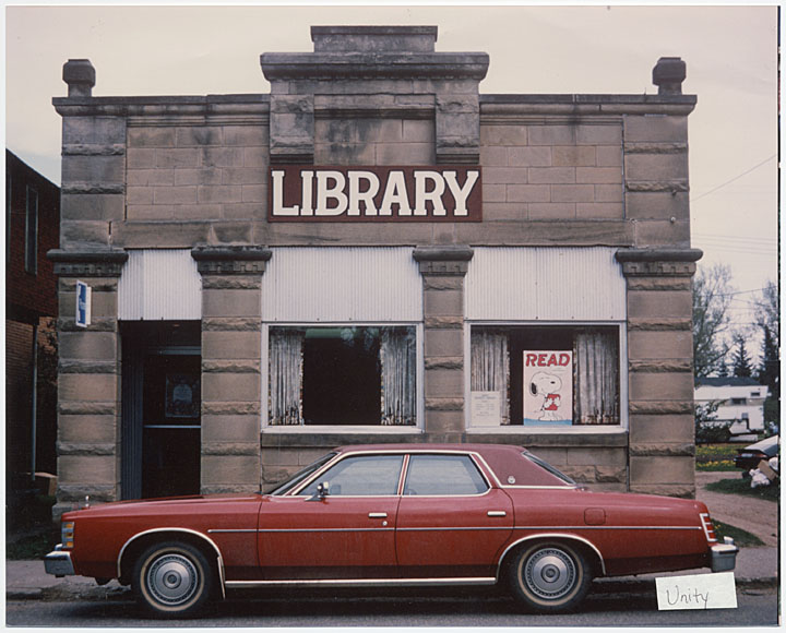 Image of branch library with red car parked in front