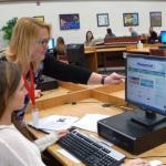 Teacher helping a student use the BadgerLink website